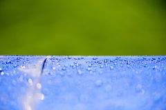 Close up Water drops pattern over a blue waterproof cloth. Background. World Water Day concept Stock Photography