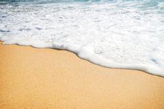 Close-up of a water edge and sand Royalty Free Stock Photo