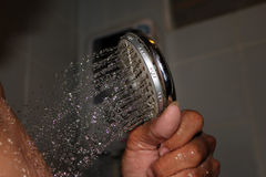 Close-up of water flowing from the shower to the body. Royalty Free Stock Photography