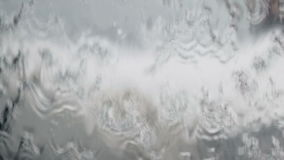Close up water flowing texture background stock footage