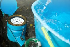 Close up water meter blue color.The bucket water in full. Royalty Free Stock Image