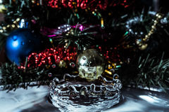 Close-up of water splash crown from tinsel, fir and Christmas toys. Royalty Free Stock Photo
