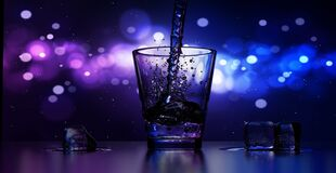 Close-up of Water Splashing in Drinking Glass Royalty Free Stock Photo