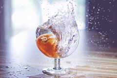 Close-up of Water Splashing in Glass Stock Photos