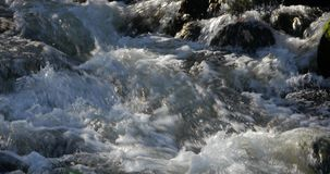Close up of water stream with white and transparent bubbles.  stock video footage