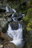 Close up of waterfall. Cascading over rocks, slow motion blur effect royalty free stock image