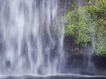 Close up of waterfall cascading over rock and moss in the Columbia River Gorge stock image