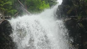 Close-up waterfall water splashing against the rocks, low angle. Stock footage stock video footage