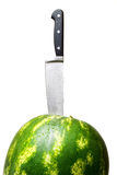 Close-up of watermelon with knife. Fresh watermelon with kitchen knife and water drops isolated over white background stock photos
