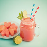 Close-up of watermelon smoothie in Mason jar decorated with lime, mint, straws Royalty Free Stock Photos