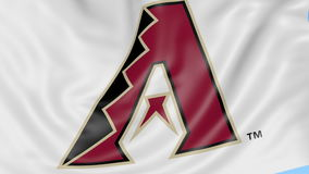 Close-up of waving flag with Arizona Diamondbacks MLB baseball team logo, seamless loop, blue background. Editorial stock video