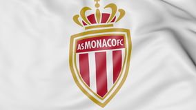 Close-up of waving flag with AS Monaco FC football club logo Royalty Free Stock Photos