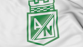 Close-up of waving flag with Atletico Nacional football club logo, 3D rendering Stock Photography