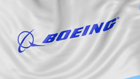 Close up of waving flag with Boeing Company logo, seamless loop, blue background. Editorial animation. 4K ProRes, alpha. Close up of waving flag with Boeing logo stock video footage