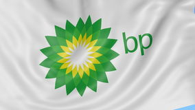 Close up of waving flag with BP logo, seamless loop, blue background. Editorial animation. 4K ProRes, alpha. Close up of waving flag with BP logo, seamless loop stock video footage