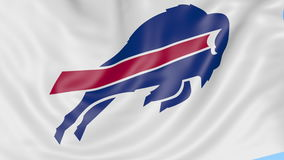 Close-up of waving flag with Buffalo Bills NFL American football team logo, seamless loop, blue background. Editorial. Animation. 4K clip stock video