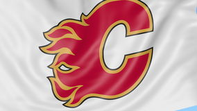 Close-up of waving flag with Calgary Flames NHL hockey team logo, seamless loop, blue background. Editorial animation. 4K clip stock footage