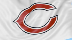 Close-up of waving flag with Chicago Bears NFL American football team logo, seamless loop, blue background. Editorial stock video footage