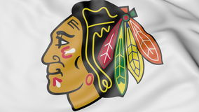 Close-up of waving flag with Chicago Blackhawks NHL hockey team logo, 3D rendering Stock Photography
