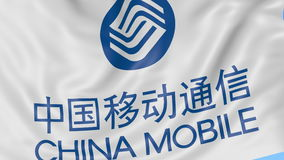 Close up of waving flag with China Mobile logo, seamless loop, blue background. Editorial animation. 4K ProRes, alpha. Close up of waving flag with China Mobile stock video footage