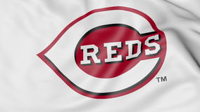 Close-up of waving flag with Cincinnati Reds MLB baseball team logo, 3D rendering Stock Photography