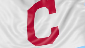 Close-up of waving flag with Cleveland Indians MLB baseball team logo, seamless loop, blue background. Editorial stock video footage