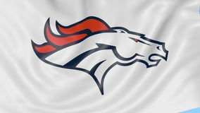 Close-up of waving flag with Denver Broncos NFL American football team logo, seamless loop, blue background. Editorial stock video footage
