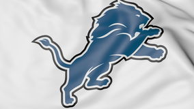 Close-up of waving flag with Detroit Lions NFL American football team logo, 3D rendering Stock Photo