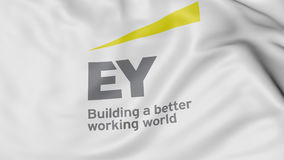 Close up of waving flag with Ernst and Young logo, 3D rendering Royalty Free Stock Photography