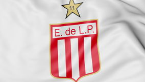 Close-up of waving flag with Estudiantes de LaPlata football club logo, 3D rendering Royalty Free Stock Images