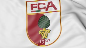 Close-up of waving flag with FC Augsburg football club logo, 3D rendering Stock Photo