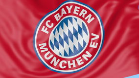 Close-up of waving flag with FC Bayern Munich football club emblem, seamless loop, blue background. Editorial animation stock footage
