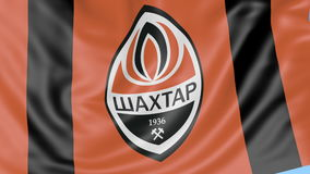 Close-up of waving flag with FC Shakhtar Donetsk football club logo, seamless loop, blue background. Editorial animation.  stock video footage