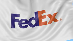 Close up of waving flag with FedEx logo, seamless loop, blue background. Editorial animation. 4K ProRes, alpha. Close up of waving flag with FedEx logo, seamless stock video footage