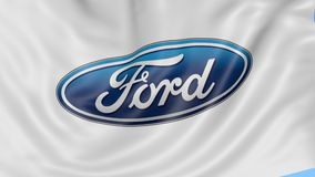 Close up of waving flag with Ford Motor Company logo, seamless loop, blue background. Editorial animation. 4K ProRes stock footage