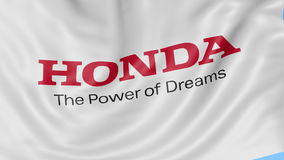 Close up of waving flag with Honda logo, seamless loop, blue background. Editorial animation. 4K ProRes, alpha. Close up of waving flag with Honda logo, seamless stock video footage