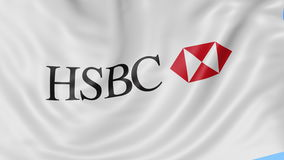 Close up of waving flag with HSBC logo, seamless loop, blue background. Editorial animation. 4K ProRes, alpha. Close up of waving flag with HSBC logo, seamless stock footage