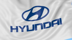 Close up of waving flag with Hyundai Motor Company logo, seamless loop, blue background. Editorial animation. 4K ProRes. Close up of waving flag with Hyundai stock video