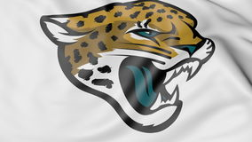Close-up of waving flag with Jacksonville Jaguars NFL American football team logo, 3D rendering. Close-up of waving flag with Jacksonville Jaguars NFL American Royalty Free Stock Images
