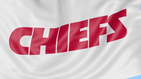 Close-up of waving flag with Kansas City Chiefs NFL American football team logo, seamless loop, blue background. Editorial animation. 4K clip stock footage