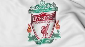 Close-up of waving flag with Liverpool F.C. football club logo Stock Images