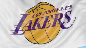 Close-up of waving flag with Los Angeles Lakers NBA basketball team logo, seamless loop, blue background. Editorial stock video