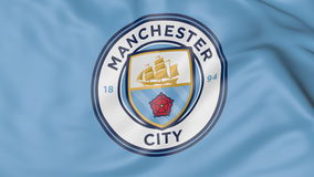 Close-up of waving flag with Manchester City F.C. football club logo Stock Image