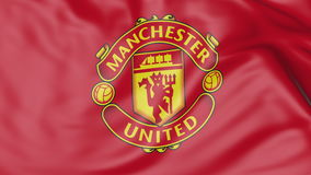 Close-up of waving flag with Manchester United F.C. football club logo Royalty Free Stock Images