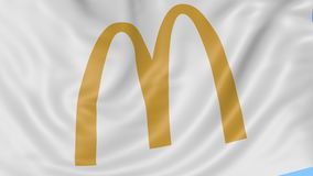 Close up of waving flag with McDonald's logo, seamless loop, blue background. Editorial animation. 4K ProRes, alpha. Flapping flag with McDonald's logo, seamless royalty free illustration