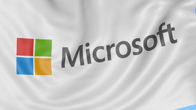 Close up of waving flag with Microsoft logo, seamless loop, blue background. Editorial animation. 4K ProRes, alpha stock footage