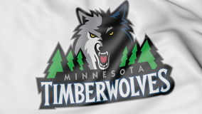 Close-up of waving flag with Minnesota Timberwolves NBA basketball team logo, 3D rendering Stock Photo