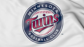 Close-up of waving flag with Minnesota Twins MLB baseball team logo, 3D rendering Royalty Free Stock Image