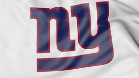 Close-up of waving flag with New York Giants NFL American football team logo, 3D rendering Stock Photo