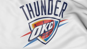 Close-up of waving flag with Oklahoma City Thunder NBA basketball team logo, 3D rendering Stock Photo